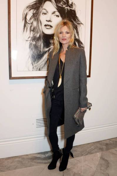 Kate Moss with her portrait. - February 3 2014
