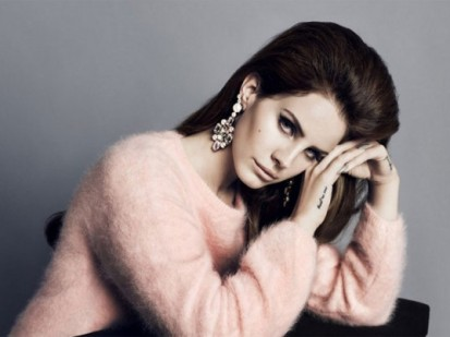 Lana del Rey wearing a garment made with Angora wool dyed pink.