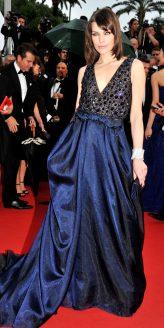 Red Carpet - Milla Jovovich wearing Armani Privé at the 66th Cannes Film Festival in 2013.