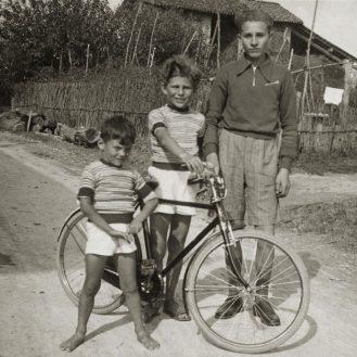 From left to right: Giorgio Armani, Sergio Armani and a family friend.