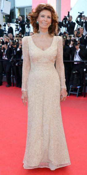 Red Carpet - Sophia Loren wearing Armani Privé at the 67th Cannes Film Festival in 2014.