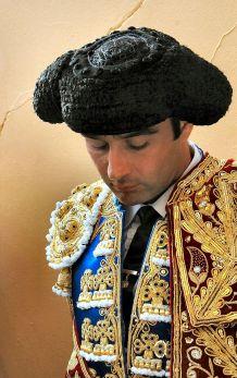 A Bullfighter wearing a Montera.