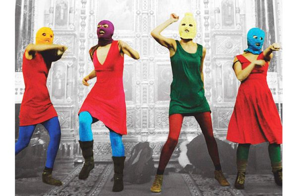 The feminist group Pussy Riot wearing balaclavas.